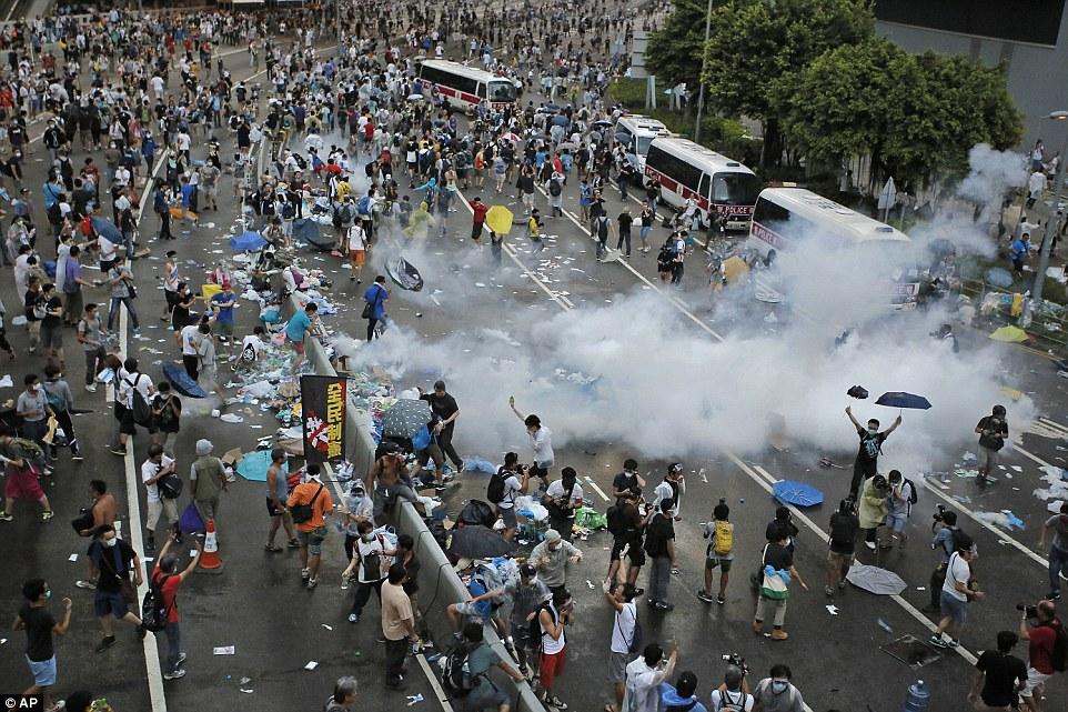 1411911641925_wps_60_Riot_police_use_tear_gas_