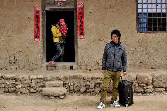 2013年2月21日,陕西陇县,30岁的杨利军早在16岁时就出去打工了。视觉中国