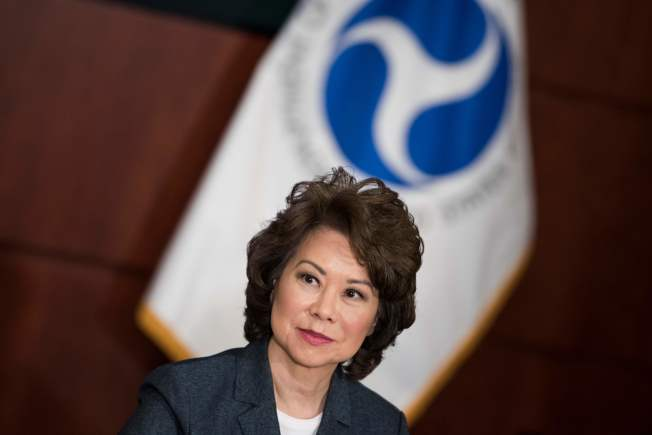 """(FILES) This file photo taken on June 9, 2017 shows US Secretary of Transportation Elaine Chao as she listens during in a roundtable discussion with US president Donlad Trump at the US Department of Transportation in Washington, DC. Donald Trump's US transportation secretary said on December 5, 2017 that she has suffered a """"me too"""" moment of sexual harassment, the first member of the president's cabinet to acknowledge being a victim of such abuse. """"Of course. I think that's the dirty little secret that a lot of women have held for a long time,"""" Elaine Chao told a Washington conference organized by the political news outlet Politico.Chao, 64, is married to Senate Majority Leader Mitch McConnell, and is serving her second stint in a presidential cabinet. She was secretary of labor for eight years during the George W. Bush administration.  / AFP PHOTO / Brendan Smialowski"""
