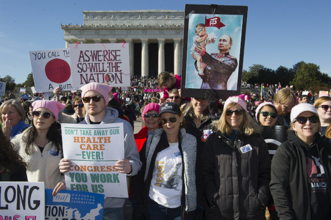 Participants in the Women's March rally at the Lincoln Memorial in Washington, Saturday, Jan. 20, 2018. Activists are returning to the streets a year after 1 million people rallied worldwide at marches for female empowerment, hoping to create an enduring political movement that will elect more women to government office. (AP Photo/Cliff Owen)