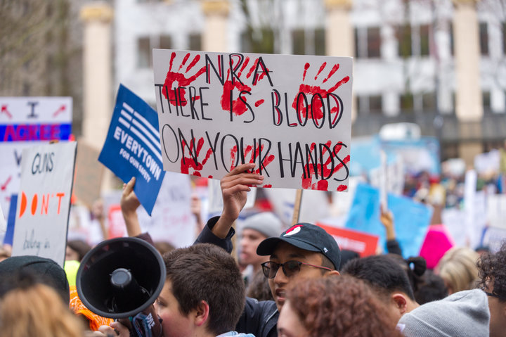 PORTLAND, OR - MARCH 24, 2018: Protesters denounce the NRA (National Rifle Association) to protest school shootings and to demand gun control during the March for Our Live on March 24, 2018, in downtown Portland, OR. (Photo by Diego Diaz/Icon Sportswire via Getty Images)