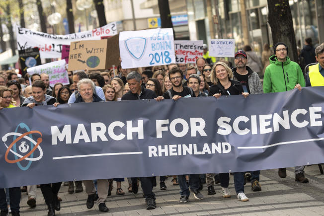 Protesters attend a 'March For Science' in Cologne, Germany, April 14, 2018 to support globally freedom of sience. (Marius Becker/dpa via AP)