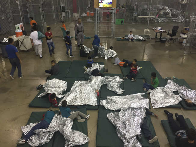 "This US Customs and Border Protection photo obtained June 18, 2018 shows intake of illegal border crossers by US Border Patrol agents at the Central Processing Center in McAllen, Texas on May 23, 2018. / AFP PHOTO / US Customs and Border Protection / Handout / RESTRICTED TO EDITORIAL USE - MANDATORY CREDIT ""AFP PHOTO / US CUSTOMS AND BORDER PROTECTION/HANDOUT"" - NO MARKETING NO ADVERTISING CAMPAIGNS - DISTRIBUTED AS A SERVICE TO CLIENTS HANDOUT/AFP/Getty Images"