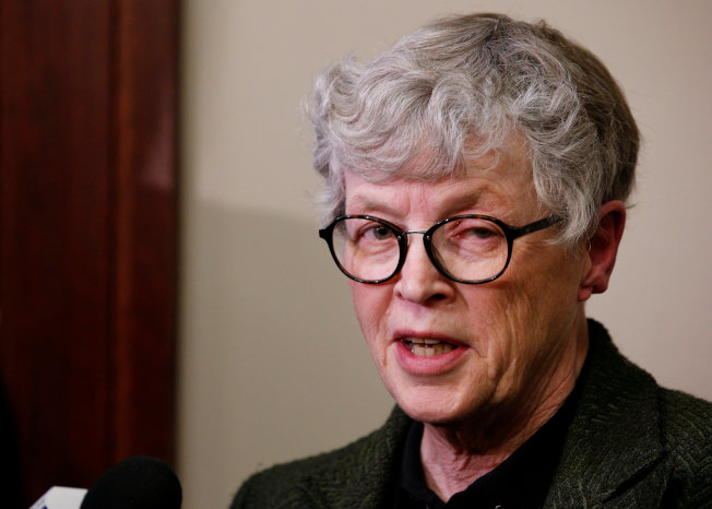 Michigan State University (MSU) President Lou Anna Simon speaks after being confronted by victims during a break at the sentencing hearing for Larry Nassar, a former team USA Gymnastics doctor who pleaded guilty in November 2017 to sexual assault charges, in Lansing, Michigan, U.S., January 17, 2018. REUTERS/Brendan McDermid