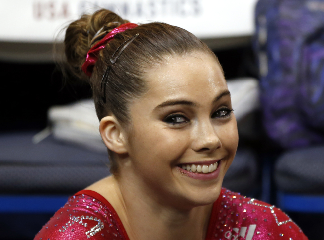 FILE - In this Aug. 17, 2013 file photo McKayla Maroney smiles after competing on the floor exercise during the U.S. women's national gymnastics championships in Hartford, Conn. Maroney says the group that trains U.S. Olympic gymnasts forced her to sign a confidential settlement to keep allegations of sexual abuse by the team's doctor secret. Maroney filed a lawsuit Wednesday, Dec. 20, 2017, in Los Angeles, against the United States Olympic Committee and USA Gymnastics. The suit also seeks damages from Michigan State University, where the team's doctor, Larry Nassar, worked for decades. (AP Photo/Elise Amendola,File)