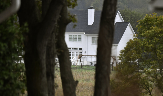 This photo shows a home on Tuesday, Oct. 16, 2018, where officials say a mother and her four children were found shot to death in an apparent murder-suicide in Columbia, Tenn. (George Walker IV /The Tennessean via AP)